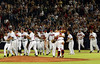 050927 - ATLANTA, GA - Fans celebrate as the 2005 Braves take the field to congratulate each other after clinching the division title after their game against the Colorado Rockies on Tuesday, September 27, 2005.  Braves won 12-3.  (JENNI GIRTMAN/STAFF)