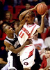 In second-half action, Georgia State's D.J. Wootson, #30, left, plays physical defense against Georgia's Adrian Jones, #11, on Friday, November 17, 2000, at Stegeman Coliseum in Athens, GA. Georgia State won the season opener against Georgia 91 to 79.