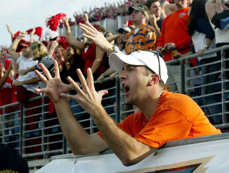 Watching as the Gators struggle in the first half, UF graduate Rob Mandarine reacts to a play Saturday, Nov. 1, 2003 at Jacksonville's ALLTEL Stadium.