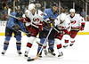 In third period action, Thrashers Patrik Stefan, left, #27, Carolina Hurricanes' Anton Babchuk, second from left, #48,  Thrashers' Brad Larsen, center, #29, Carolina's Chad LaRose, second from right, #59,  and Carolina's Aaron Ward, right, #4,  all work for possession of the puck at Philips Arena on Saturday, April 1, 2006.  Thrashers win 5-2.