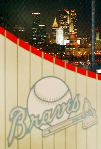030919 - ATLANTA, GA - As the Braves seal their victory against the Florida Marlins darkness sets in on Atlanta on Friday, Sept. 19, 2003. (JENNI GIRTMAN/STAFF)