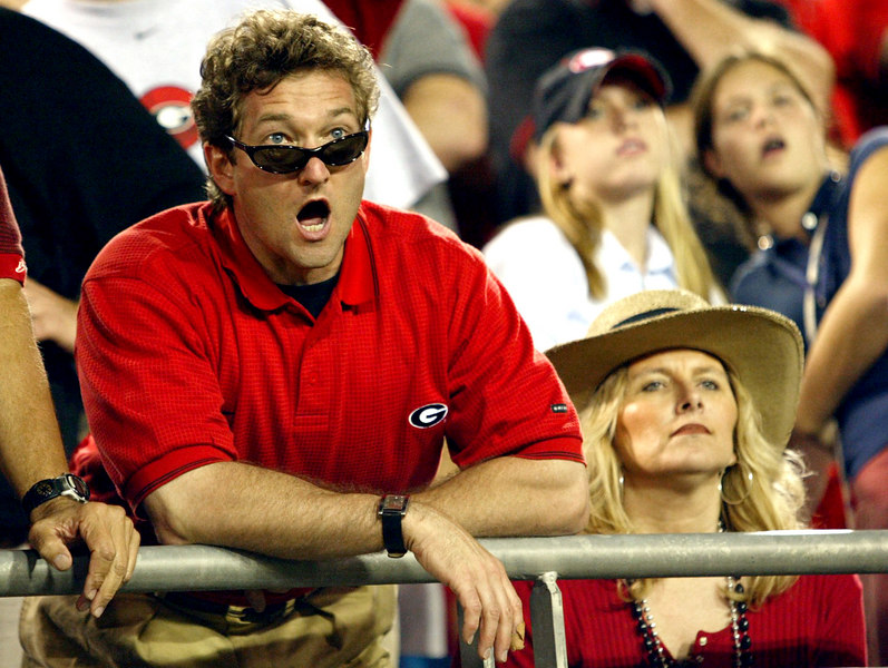 As the final seconds of the UGA vs. FL game tick away, David Wren and his wife Vicki Wren react to the game in Jacksonville, GA on Saturday, Nov. 1, 2003.