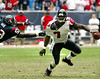 Houston Texans' Shantee Orr, left, #53, stops quarterback Michael Vick, 7, right, in the second-half action during the Falcons' game against Houston in Reliant Stadium on Sunday, Nov. 30, 2003. The Texans won the game 17-13.