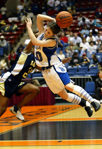 In second half action, Early County High School's Miranda Wright, left, #12, fouls Paideia High School's Katie Payne, #30, right, on Thursday, March 6, 2003 at the Macon Centreplex. Early County won the game 52-46 against Paideia High School.
