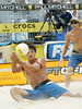 During the final best of three match of the four-day AVP Beach Volleyball tournament, Mike Lambert, left, keeps the play alive as his teammate Stein Metzger, right back, watches on at Atlantic Station on Sunday, July 9, 2006.