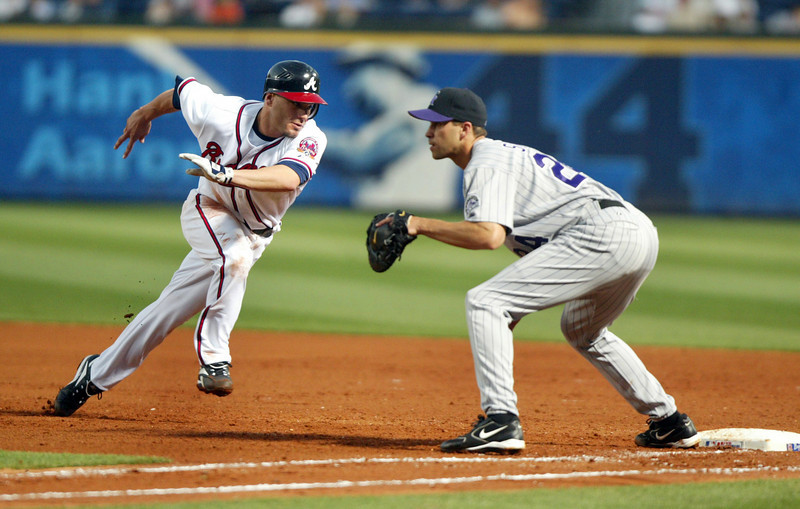 060501 - ATLANTA, GA - Marcus Giles, #22, left, (cq) makes it safely back to first base in 4th inning action against Rockies Jason Smith, #24, right, (cq) in a Braves 2-0, one-hit game against the Rockies on Monday, May 1, 2006.   (JENNI GIRTMAN/STAFF)