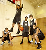 Fayette County High School's starters Cameron Carruthers #11, from left, Brandon Henderson #5, Chris Pettaway #4, Jeremiah Enloe #21 and Channing Welch #45 offer a different-player-every-night quality to the basketball team.  Photo taken Wednesday, Jan. 18, 2006.
