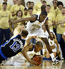 Georgia Tech's Jeremis Smith, #32, on ground works to maintain control of the ball from Duke's Lee Melchionni, #13, left,  as Tech's Anthony Morrow, top, standing, #23, looks for an opportunity in first half action at Alexander Memorial Coliseum on Wednesday, Feb. 22, 2006. Tech is up at the half 39-34.