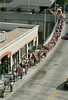 000621 - ATLANTA, GA - On the way to see the Braves vs. the Chicago Cubs at Turner Field, baseball fans file out of the Five Points MARTA station Wednesday, June 21, 2000, and wait in line for a MARTA bus on Forsyth Street. (JENNI GIRTMAN/AJC staff)