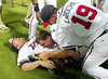 Jeff Francoeur, on ground, left,  Chipper Jones, center,  and Adam LaRoche, right,  celebrate after clinching the division title after their game against the Colorado Rockies on Tuesday, September 27, 2005. Braves won 12-3.
