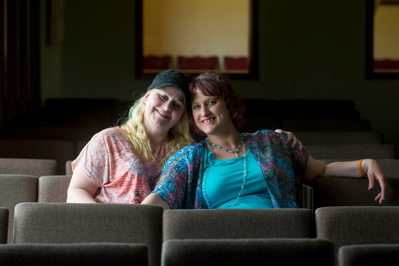 Tami Frederick, left, sits with her sister Jenni Tiderman after attending Revolution Church in Port Angeles together on May 6, 2018. The two credit the support they recieve at Revolution Church for helping them remain succesful in their recovery from drug addiction. (Jesse Major/Peninsula Daily News)