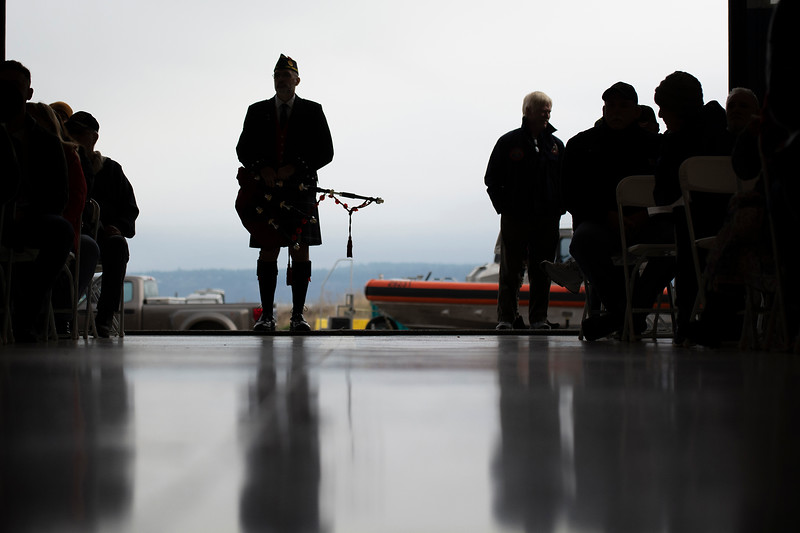 Retired Coastguardsman Rick McKenzie prepares to play bagpipes during the Veterans Day ceremony at U.S. Coast Guard Air Station/Sector Field Office Port Angeles Nov. 11, 2019. (Jesse Major/Peninsula Daily News)
