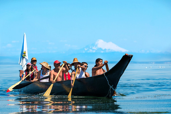 Members of the Mowachaht Tribe's canoe family arrive to Jamestown during the Power Paddle to Puyallup on July 22, 2018.  (Jesse Major/Peninsula Daily News)