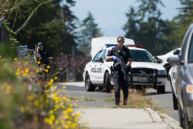 Port Angeles police carried rifles as they attempted to serve a warrant on the 1600 block of West Seventh Street on Wednesday. (Jesse Major/Peninsula Daily News)