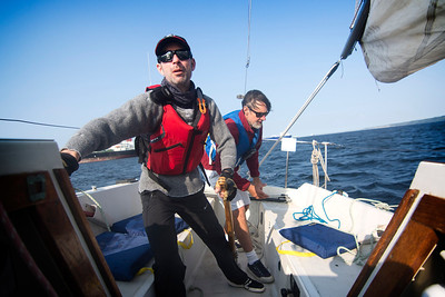 """Jared Tait, left, and Keith Dahlin sail in the Port Angeles Yacht Club's """"beer can"""" race on July 29, 2019. (Jesse Major/Peninsula Daily News)"""