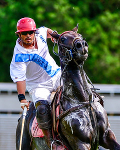 J. Pasten of team La Barra  playing in the 3rd chucker of the game presses hard for a scoring shot. George S. Patton Jr. Tournamaent at Congressional Polo Club. Photo credit David Wolfe.