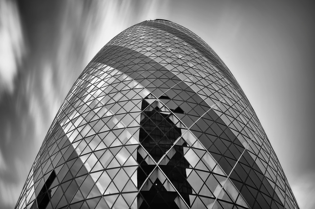 Photograph: The Cloudy Gherkin - Long exposure, monochrome photograph of The Gherkin skyscraper in London, England.