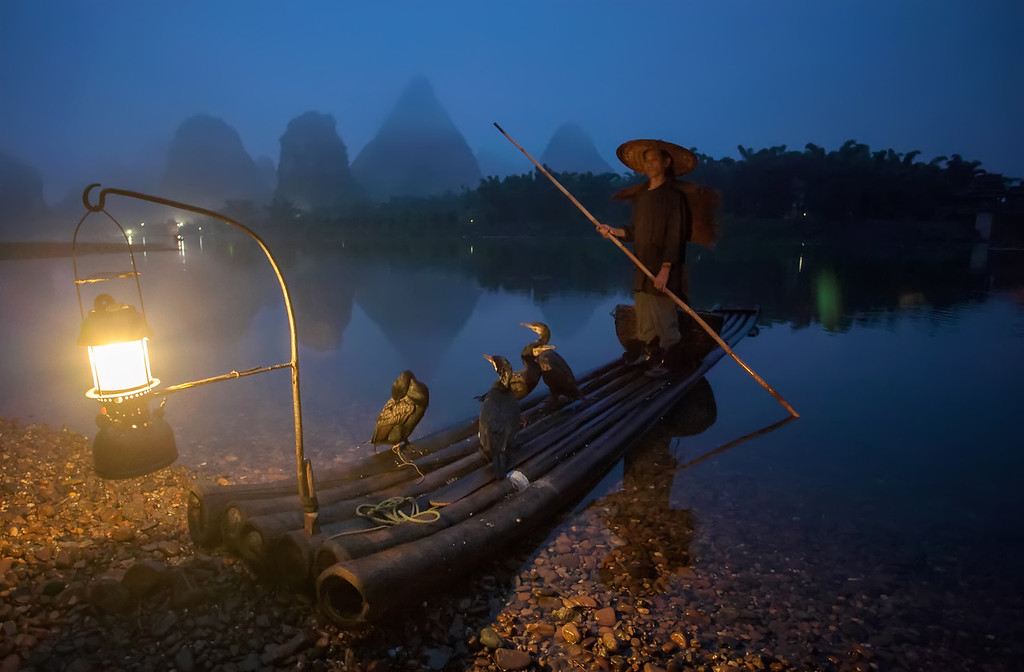 Photograph: Setting Off - A cormorant fisherman sets off down the Li River.