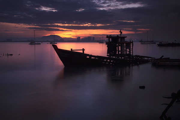 Photograph: Sunken - A sunken shipwreck off the Tan Jetty in Penang, Malaysia.