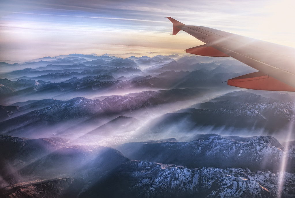 Photograph: The Alps - HDR sunset photograph taken from a plane window flying over the Julian Alps.