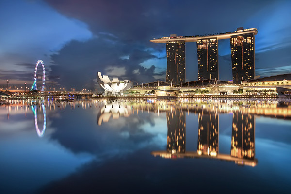 Photograph: The Lion City - Sunrise blue hour of Marina Bay in Singapore.