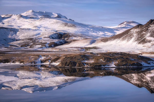 Photograph: Fjord Focus - Morning reflections in a fjord of the surrouding mountains.