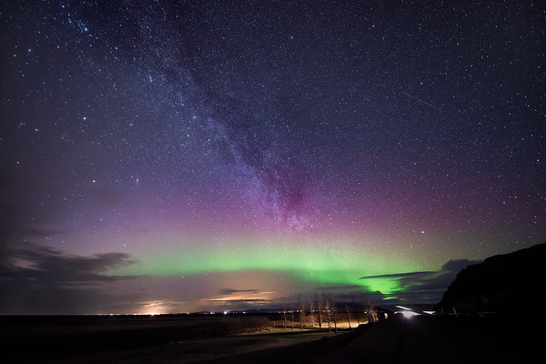 Photograph: Suspended in the Evening Skies - Milky Way and Aurora Borealis by Seljalandsfoss in South Iceland.