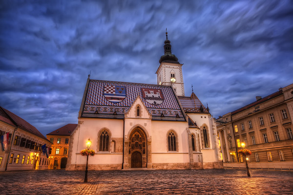Photograph: A Stormy Night in Zagreb - A stormy sky above St Mark's church in Zagreb, Croatia.