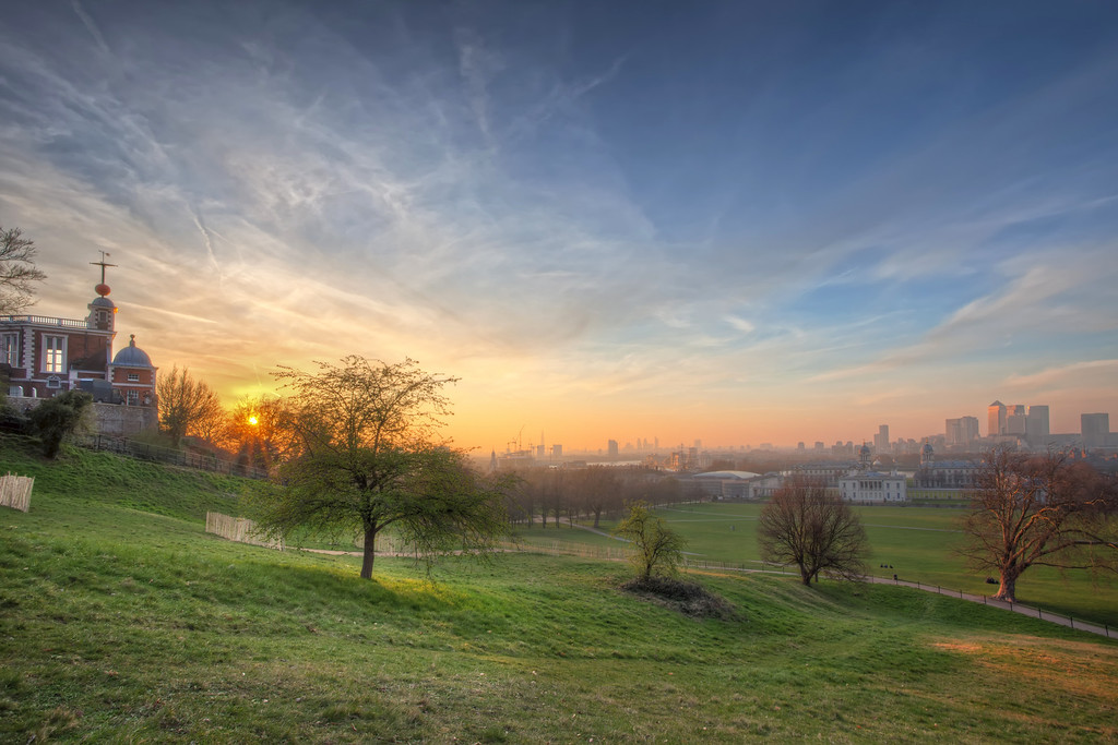 Photograph: Greenwich Park - Cloudy sunset over Greenwich park with the London skyline in the distance including Canary Wharf and The City.