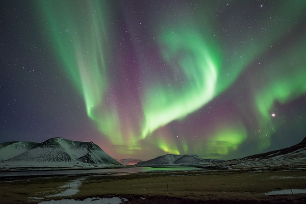 Photograph: Dance of the Heavens - The aurora borealis over the Snæfellsnes Peninsula in West Iceland.