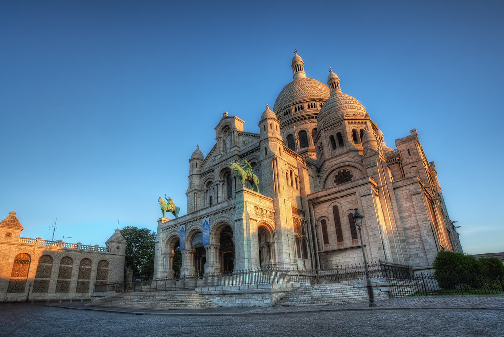 Photograph: Golden Glow - HDR photograph of the golden morning light of sunrise hitting the Sacré-Cœur in Paris, France.