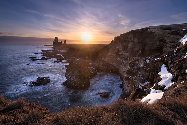 Photograph: The Cliff of a Thousand Birds - Sunset by a cliff of nesting birds in Iceland.