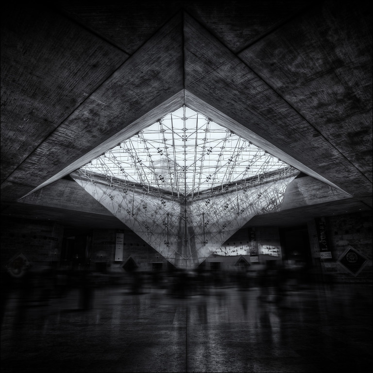 Photograph: Ghosts - Fine-art, monochrome photograph of La Pyramide Inversée in the Louvré Museum, Paris, France.
