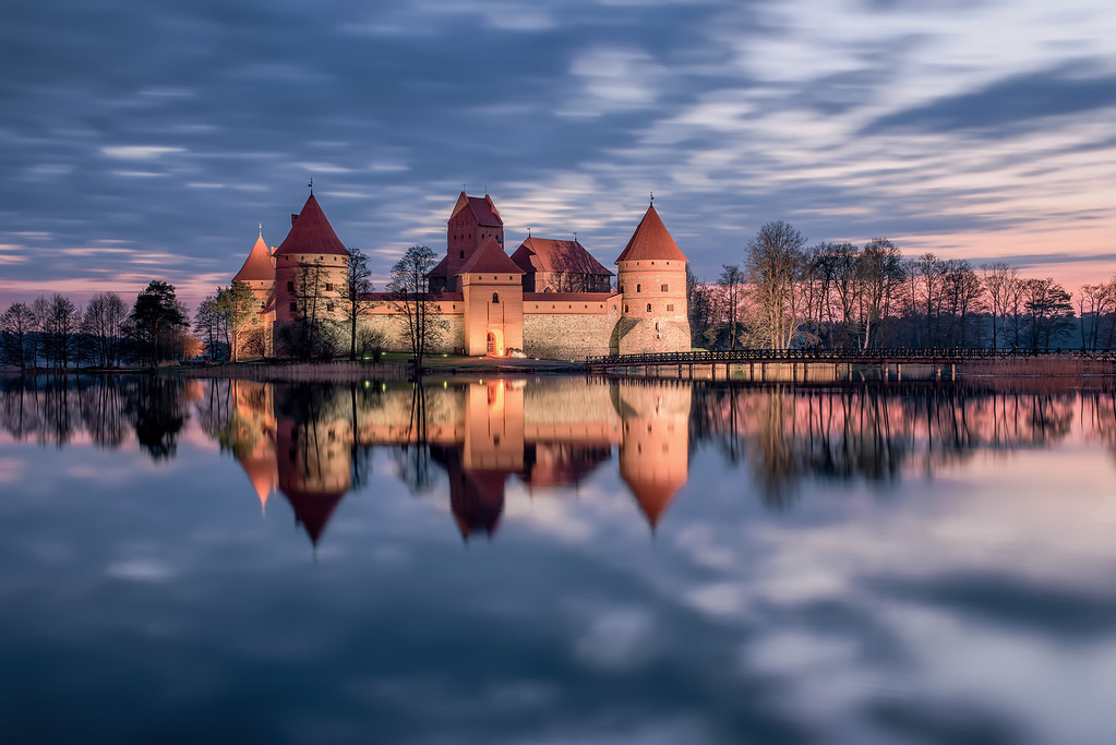 Photograph: Trakai Island Castle - Reflection of Trakai Island Castle in Lithuania at sunrise.