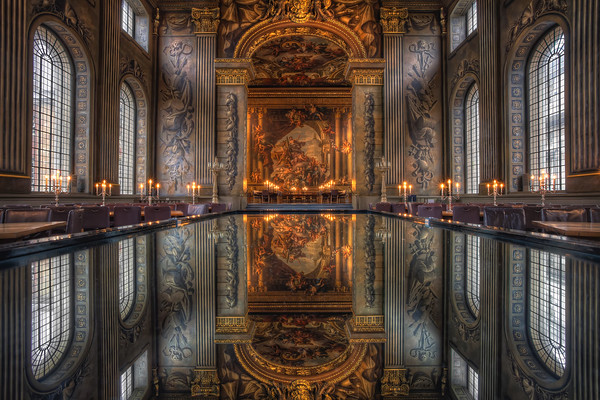 Photograph: The Painted Hall - Interior photograph of the Painted Hall in the Old Royal Naval College, Greenwich, London, reflected on a glass table.