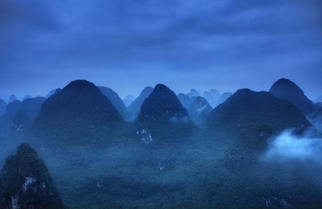 Photograph: Blue Ridge Mountains - Sunrise blue hour landscape photograph of the karst limestone mountains in Yangshuo, part of the Guilin prefecture in Guangxi, South China.