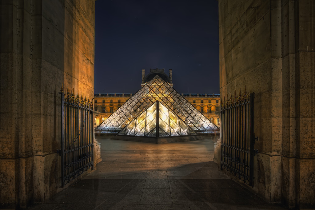 Photograph: Pyramids - Almost surreal shot of the glass pyramids in the courtyard of the Louvre Museum.