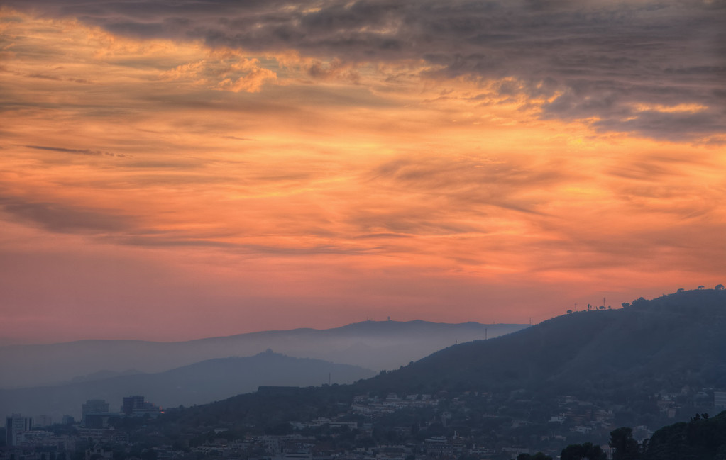 Photograph: The Hills of Barcelona - Glorious cloudy sunset over the hills of Barcelona in Spain's Catalan region.