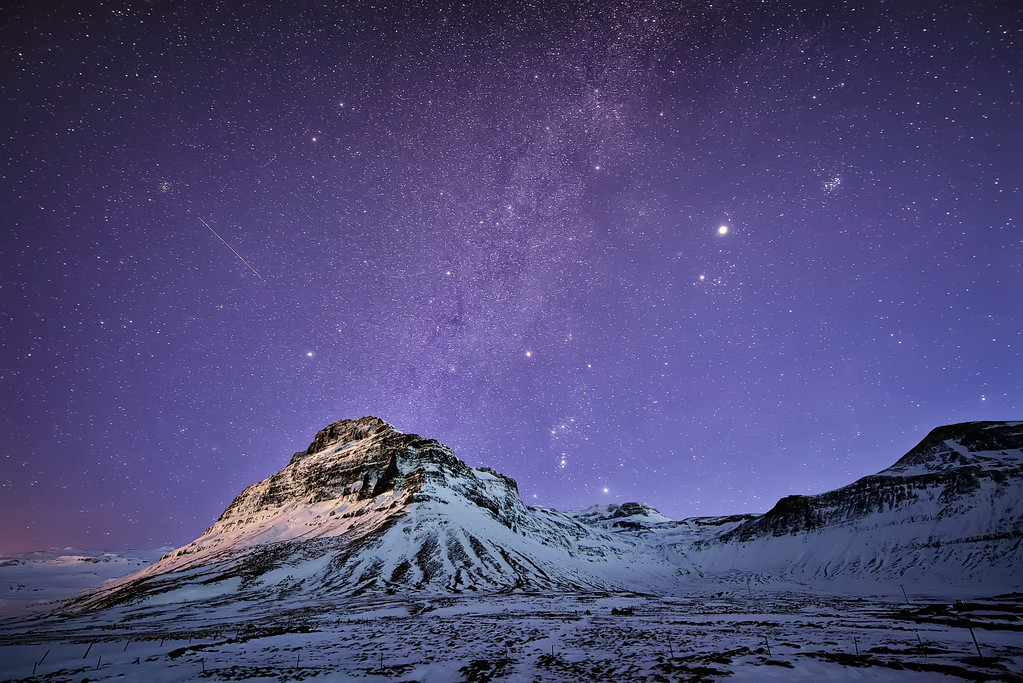 Photograph: Celestial Bodies - The night sky above a mountain in Snæfellsnes, Iceland.
