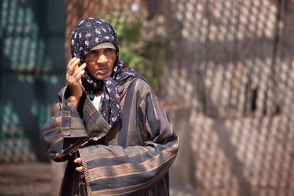 Photograph: Moroccan Lady - Candid travel photo of a women in Marrakesh, Morocco.