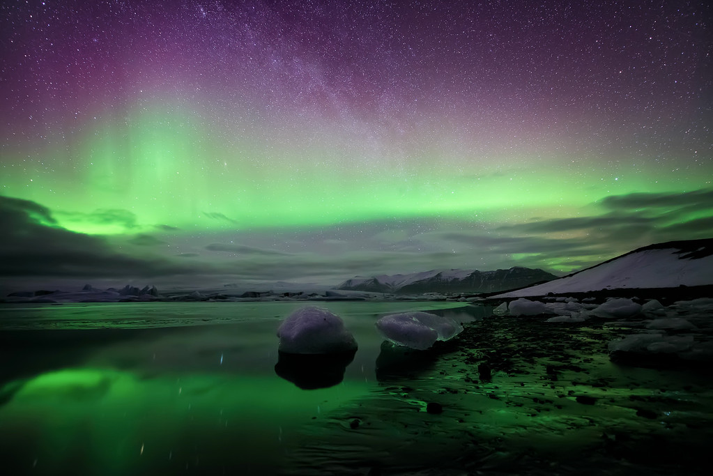 Photograph: Aurora Over The Ice Lagoon - The Aurora Borealis over Jökulsárlón ice lagoon in South Iceland.