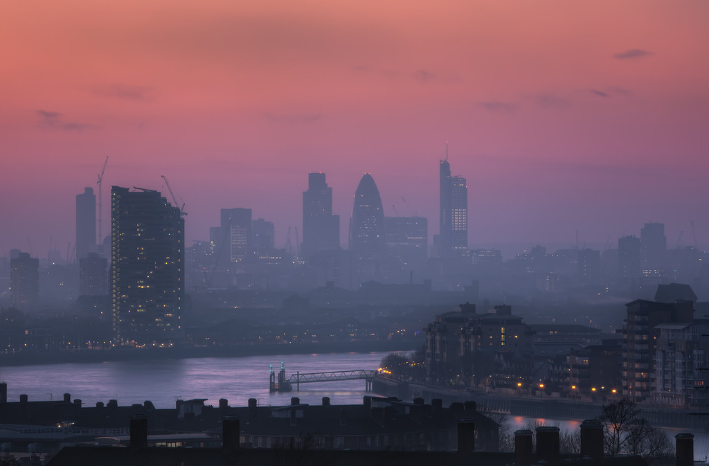 Photograph: Hazy London - Hazy sunset over The City, showing some of London's famous skyscrapers including The Gherkin, Tower 42 and Heron Tower.