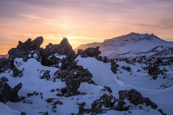 Photograph: Sunrise at the Lava Field - A golden sunrise over jagged volcanic rocks in Snæfellsnes, Iceland.