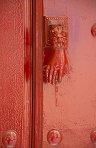 Crimson hand door knocker, Seville