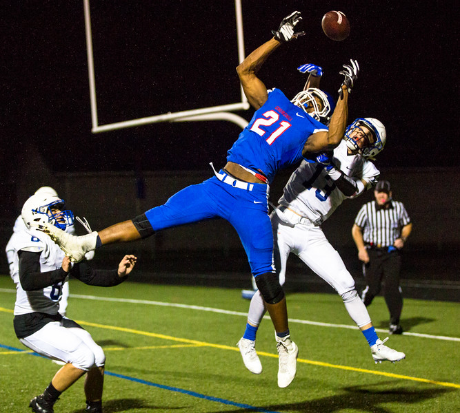 Churchill Lancers wide reciever Lucas Wilson (#21) jumps for a pass. Eagle Point defeated Churchill 42-37.