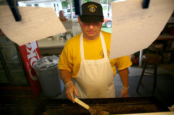 Charleston Lion's Club preisdent Steve Ferguson works the grill in the Lion's Club food stand at the Coles County Fair Grounds in Charleston, Illinois on Thursday, July 30, 2009.  (Jay Grabiec)
