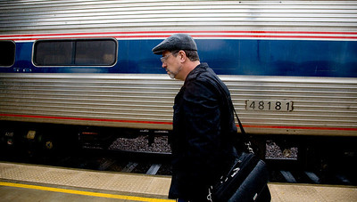 Amtrak Engineer Steve Flemming is seen walking past the Missouri River Runner train after driving the train from Kansas City, Missouri to St.  Louis, Missouri station on December 24, 2009.  (Jay Grabiec)