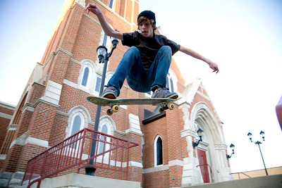 Haiden Rawlings, 16, Mattoon, in mid-air while doing a four step ollie off of the steps of Immaculate Conception Catholic Church in Mattoon, Illinois on Monday October 5, 2009.  (Jay Grabiec)