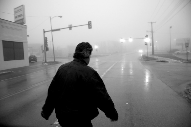 Minor James Miller Junior walks across Charleston Avenue to get from the PADS shelter to Courtesy Cleaners in Mattoon, Illinois early in the morning on December 19, 2009. The 63-year old Miller is forced to walk most of the time since he does not own a car.  (Jay Grabiec)