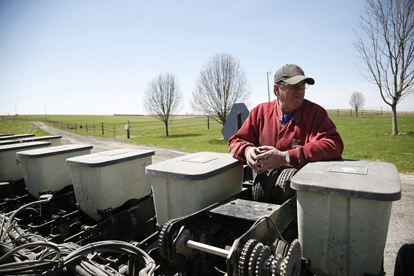 Arnie Ralston watches on as his son Nate makes repairs to a seeder to prepare for the planting season at a barn near Nate's house off of IL route 130 about twelve miles south of Charleston, Illinois on Friday April 4, 2008.  (Jay Grabiec/Staff Photographer)